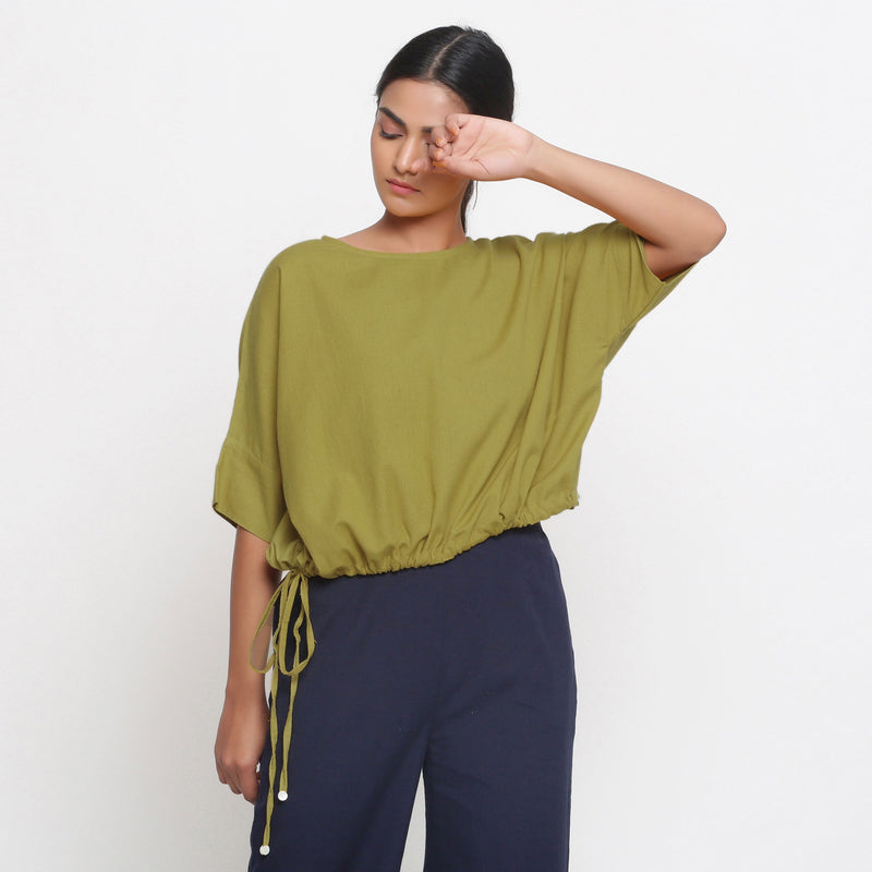Front View of a Model wearing Solid Green Cotton Flax Blouson Top