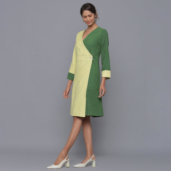 Left View of a Model wearing Cotton Corduroy V-Neck Wrap Dress