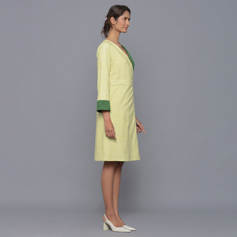 Right View of a Model wearing Cotton Corduroy V-Neck Wrap Dress