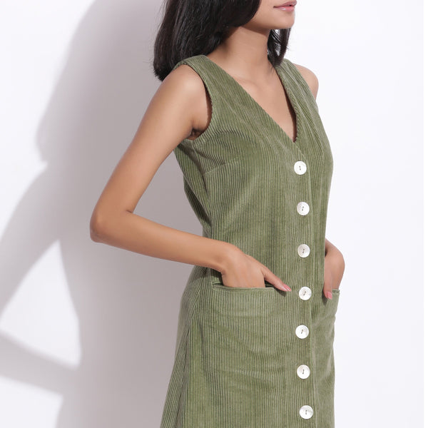 Front Detail of a Model wearing Cotton Corduroy Green Button-Down Dress