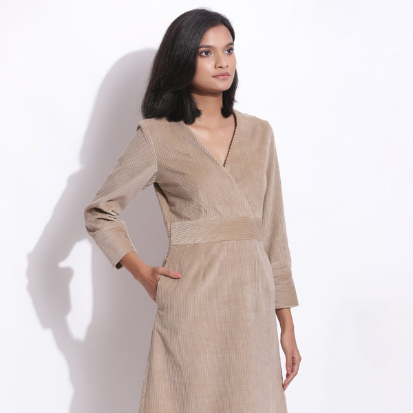 Front Detail of a Model wearing Cotton Corduroy Taupe Beige Surplice Dress
