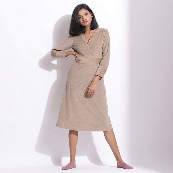Front View of a Model wearing Cotton Corduroy Taupe Beige Surplice Dress