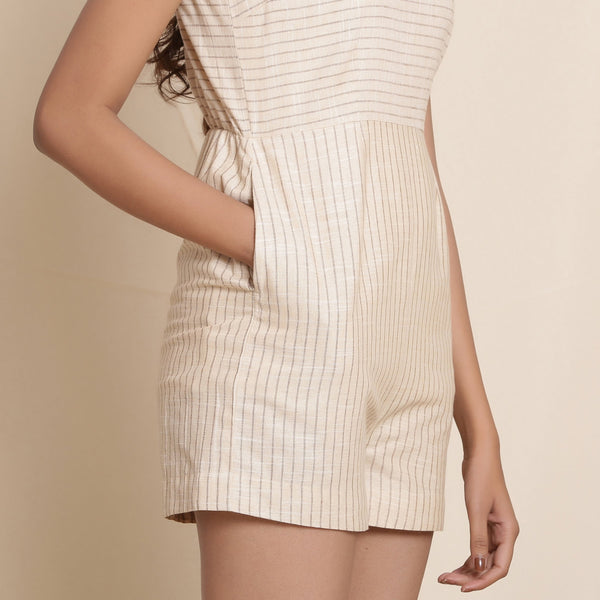 Front Detail of a Model wearing Cotton Dusk Beige Striped Sleeveless Romper