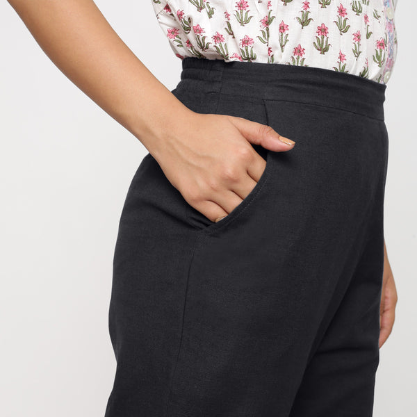 Right Detail of a Model wearing Cotton Flax Mid-Rise Black Tapered Pant