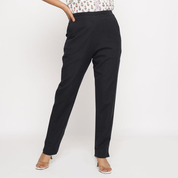 Front View of a Model wearing Cotton Flax Mid-Rise Black Tapered Pant