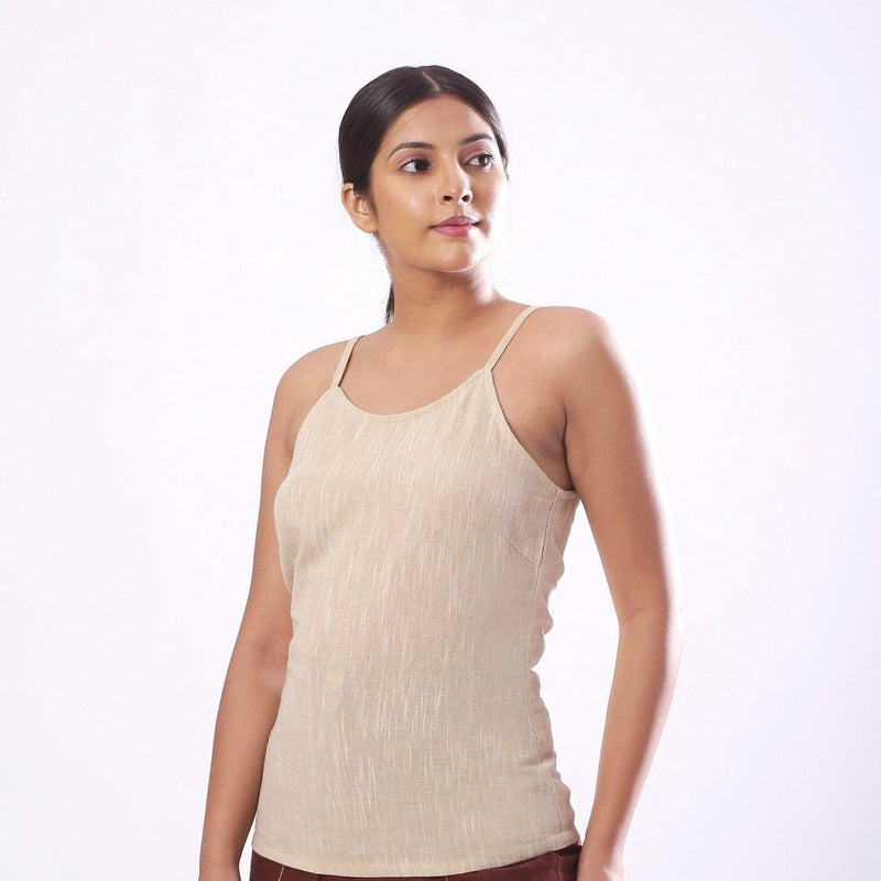 Left View of a Model wearing Solid Beige Cotton Flax Spaghetti Top