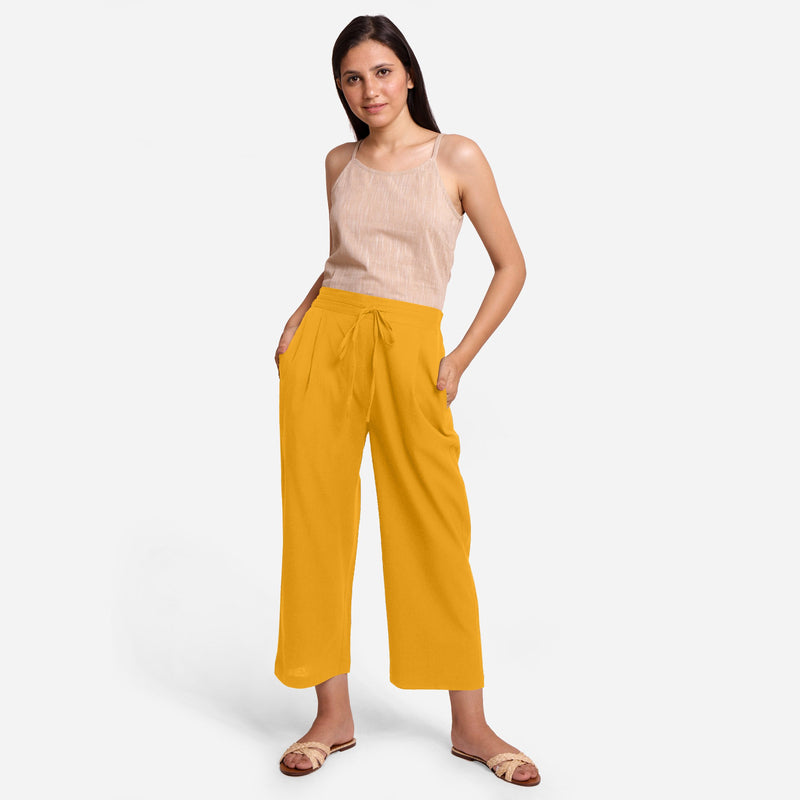 Front View of a Model wearing Cotton Flax Spaghetti Top and Yellow Pant Set
