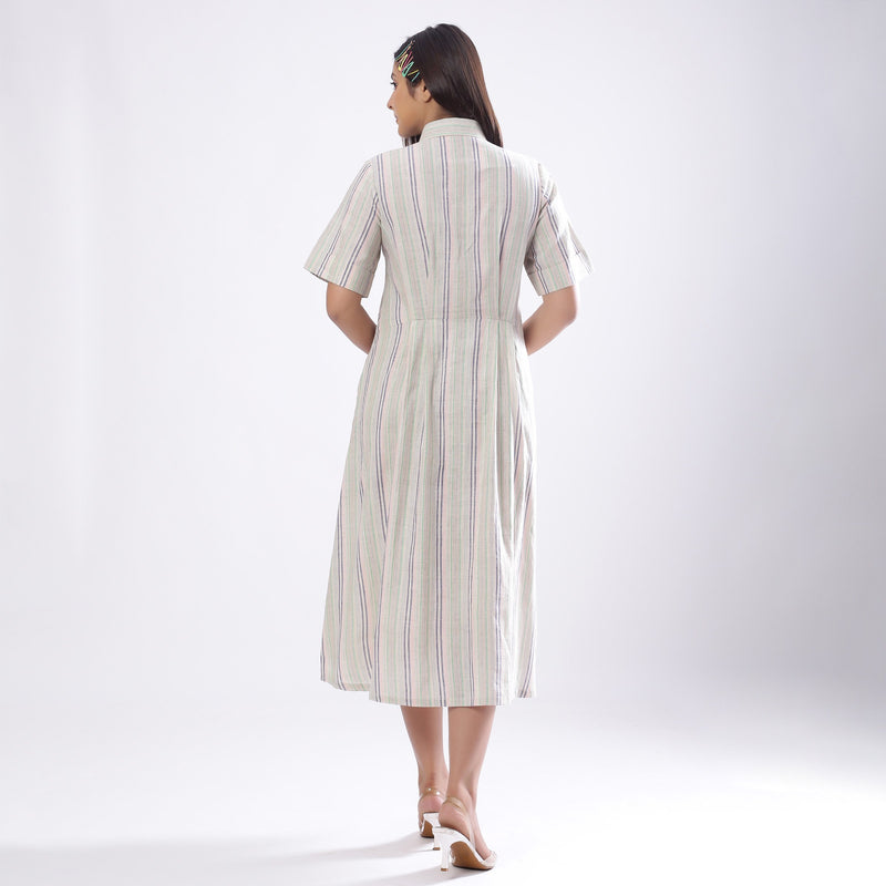 Back View of a Model wearing Handspun Cotton Muslin Button-Down Shirt Dress