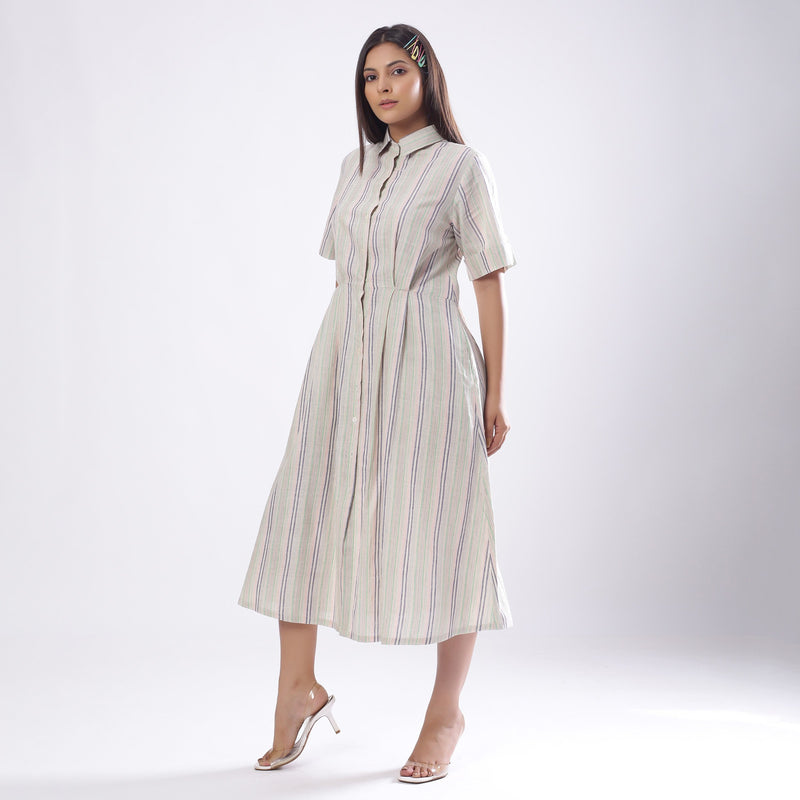 Left View of a Model wearing Handspun Cotton Muslin Button-Down Shirt Dress
