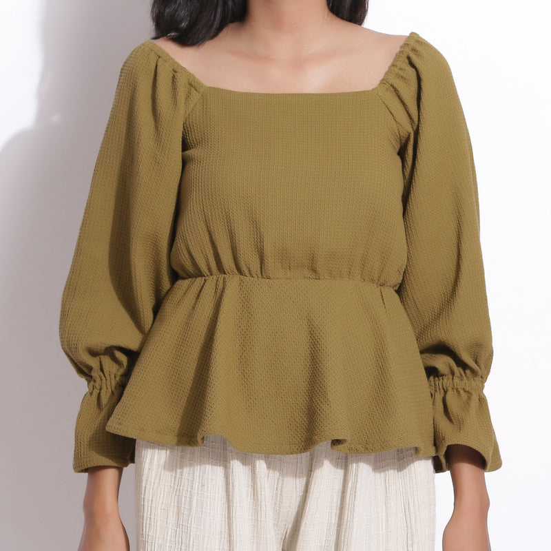 Front Detail of a Model wearing Cotton Waffle Olive Green Peplum Top