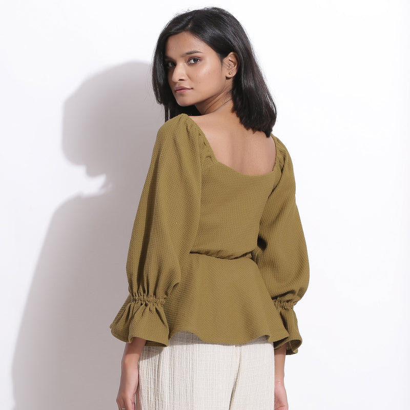 Back View of a Model wearing Cotton Waffle Olive Green Peplum Top