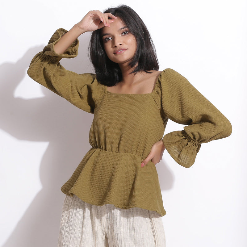 Front View of a Model wearing Cotton Waffle Olive Green Peplum Top