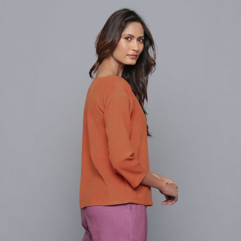 Right View of a Model wearing Sunset Rust Corduroy Drop Shoulder Top