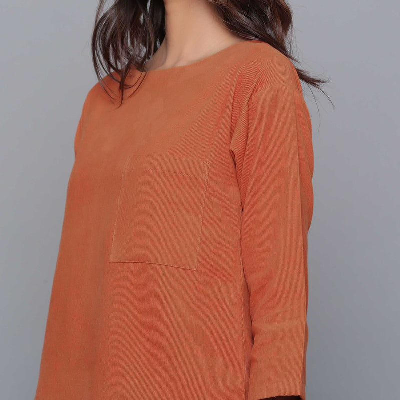 Front Detail of a Model wearing Sunset Rust Corduroy Drop Shoulder Top
