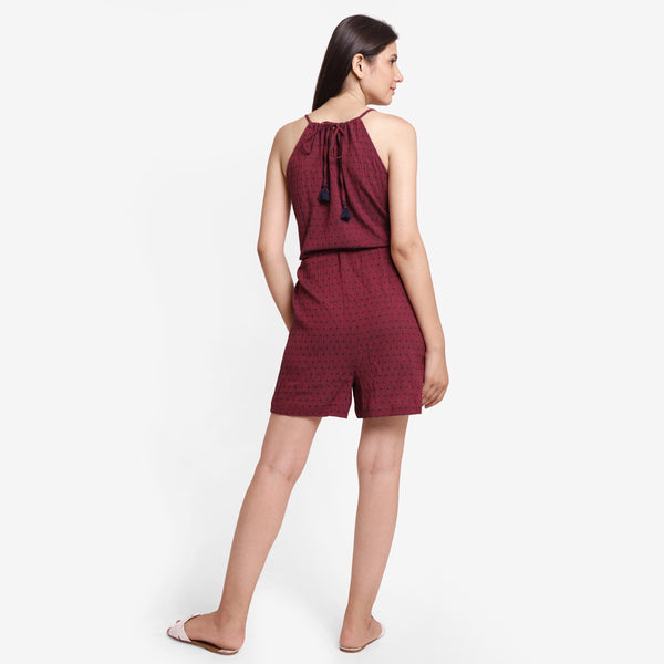 Back View of a Model wearing Crimson Polka Dot Halter Neck Romper