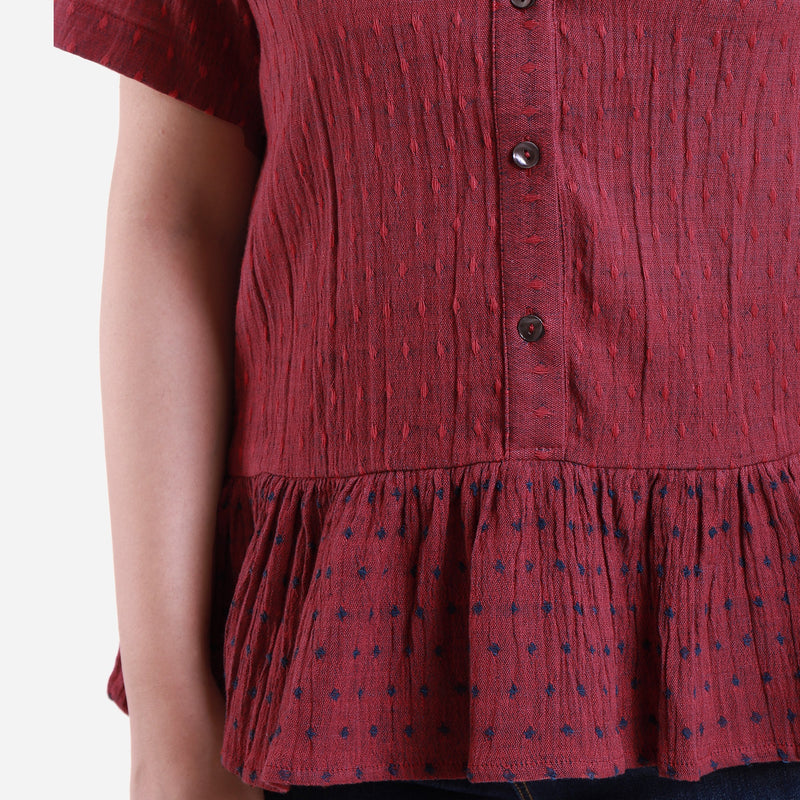 Front Detail of a Model wearing Crimson Crinkled Cotton Polka Dot Peplum Top