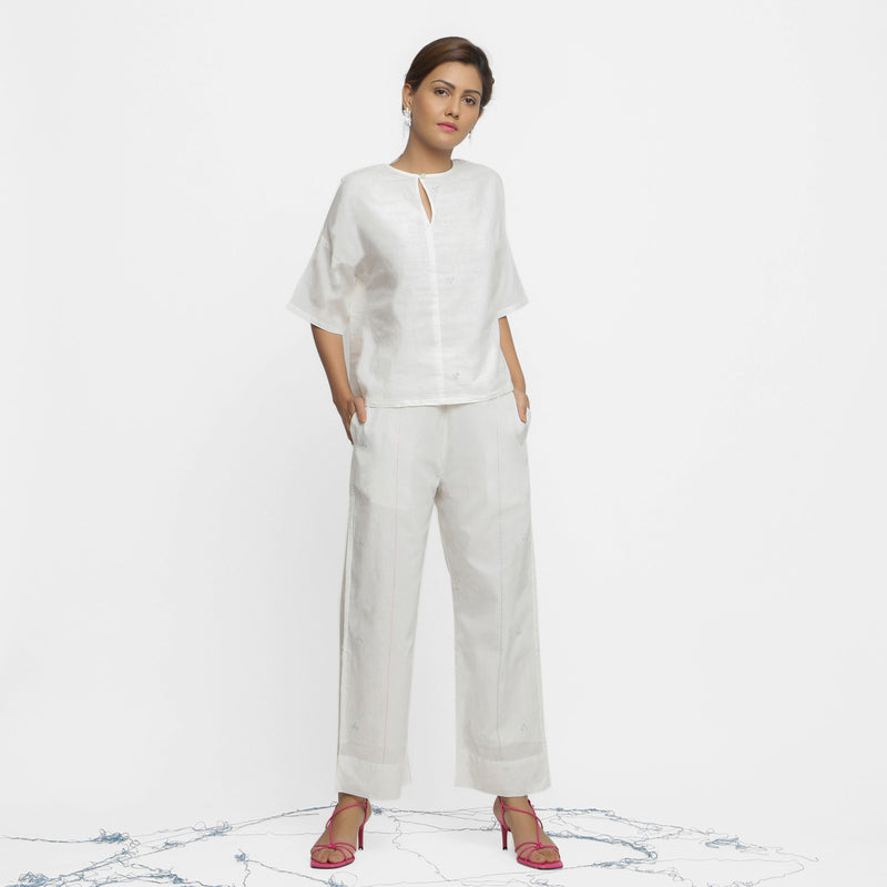 Front View of a Model wearing Off-White Hand Embroidered Top and Pant Set