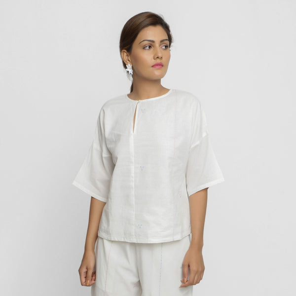 Front View of a Model wearing Hand Embroidered Organic Cotton Paneled Top