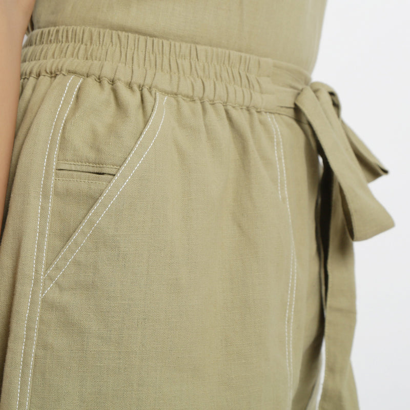 Right Detail of a Model wearing Khaki Vegetable Dyed Handspun Short Shorts