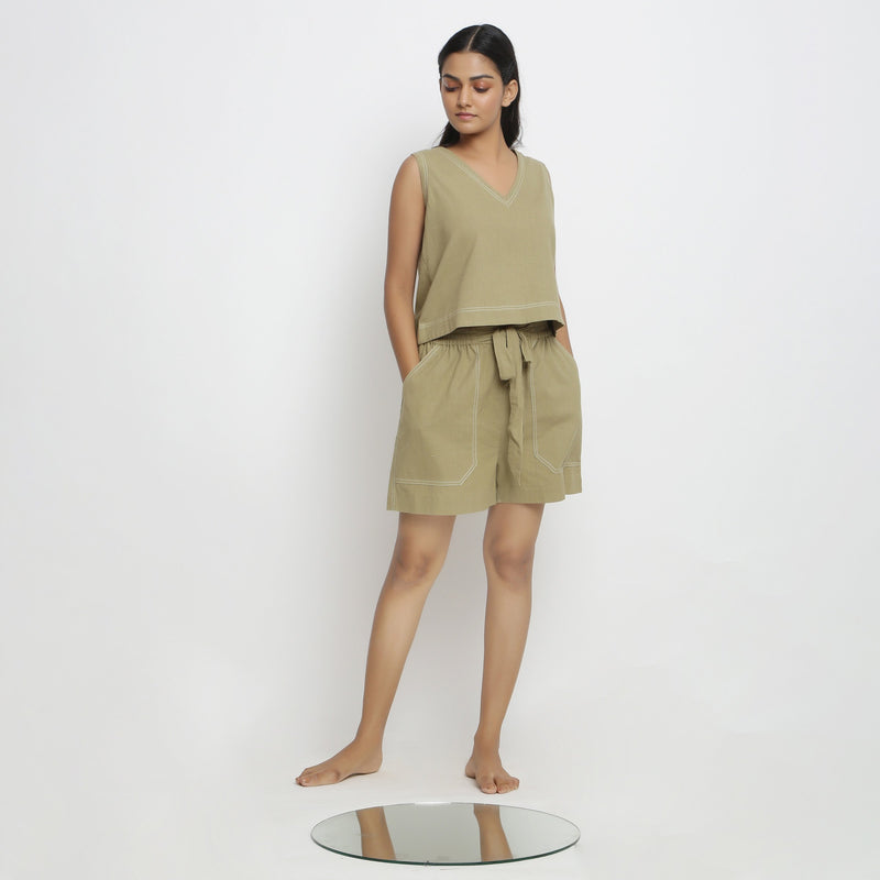 Front View of a Model wearing Crisp Khaki Green Top and Handspun Shorts Set