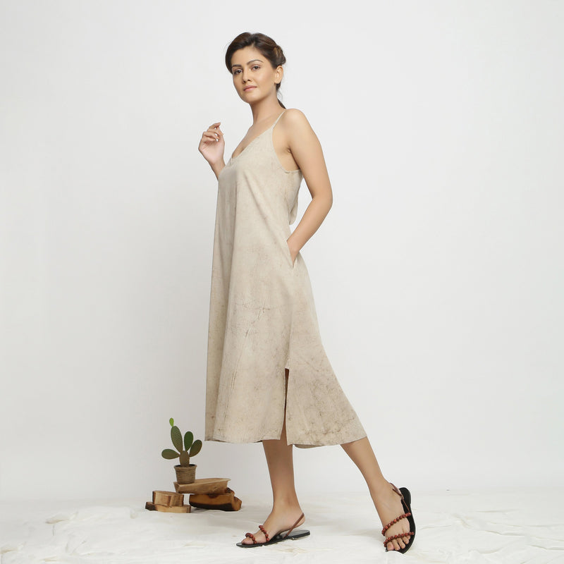 Left View of a Model wearing Dabu Hand-Lep A-Line Beige Dress