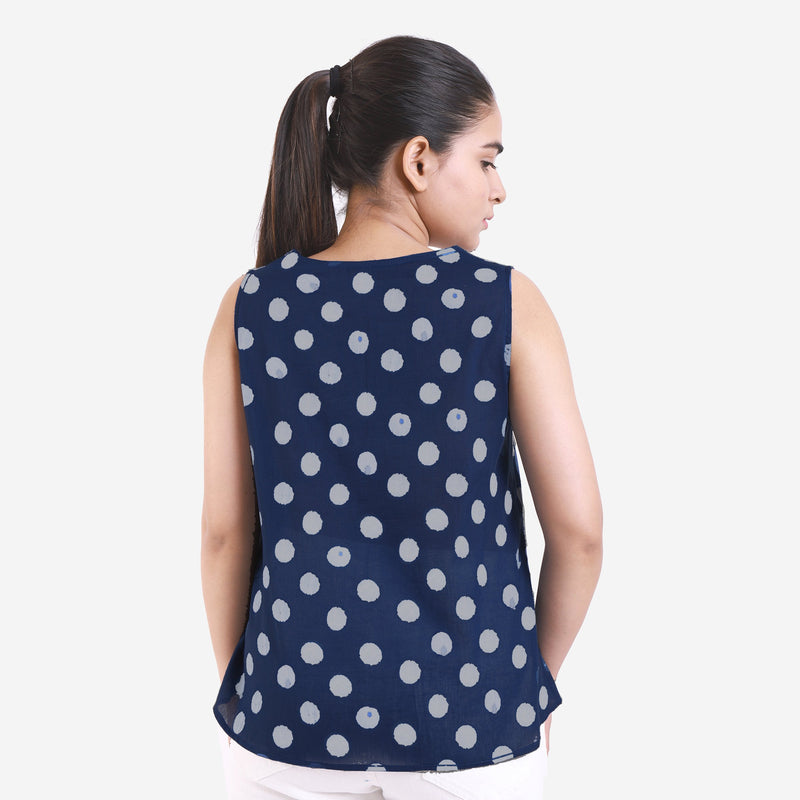Back View of a Model wearing Dabu Polka Dot High-Low Straight Top