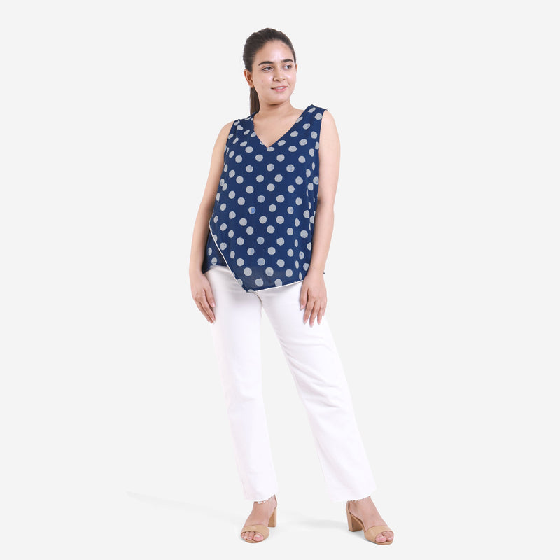 Front View of a Model wearing Dabu Polka Dot High-Low Straight Top