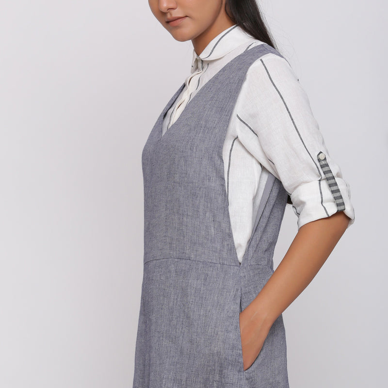 Left Detail of a Model wearing Deep V-Neck Charcoal Grey Pinafore Dress