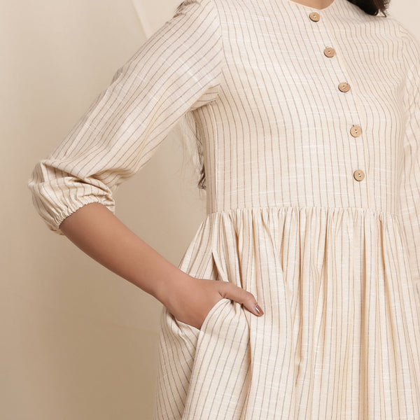 Front Detail of a Model wearing Warm Flannel Dusk Beige Gathered Dress