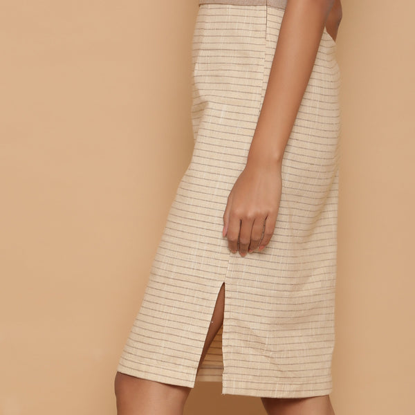 Left Detail of a Model wearing Dusk Beige Slim Fit Shift Dress