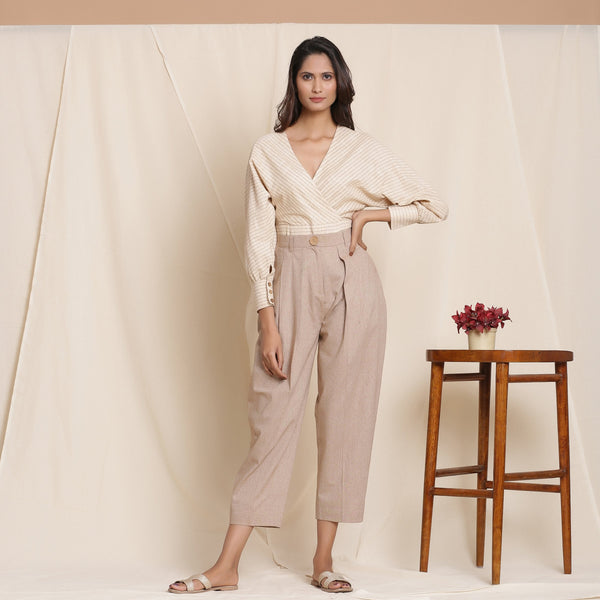 Front View of a Model wearing Dusk Brown Box Pleated Pegged Pant