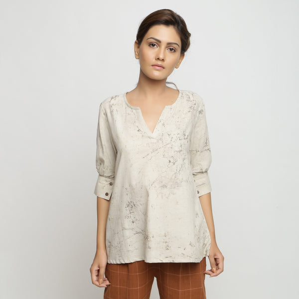 Front View of a Model wearing Beige Dabu Printed Deep Neck A-Line Top