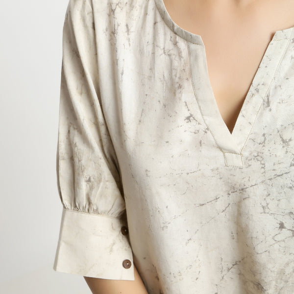 Front Detail of a Model wearing Beige Dabu Printed Deep Neck A-Line Top