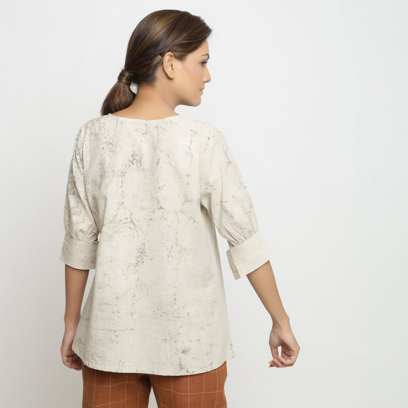 Back View of a Model wearing Beige Dabu Printed Deep Neck A-Line Top