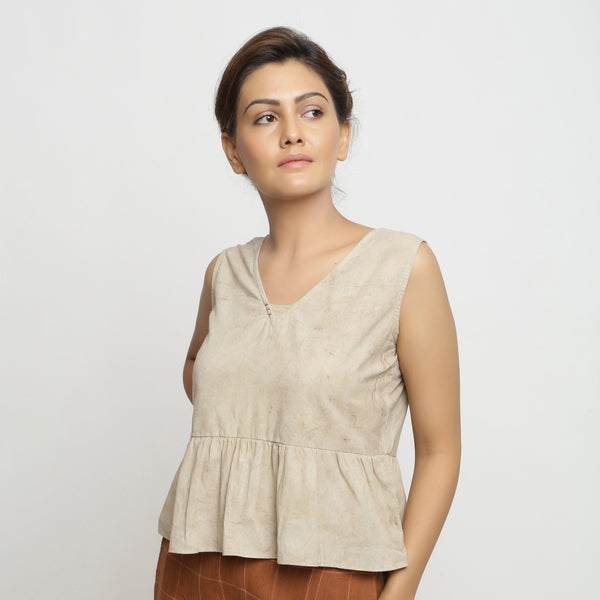Front View of a Model wearing Beige Dabu Printed Sleeveless Gathered Top