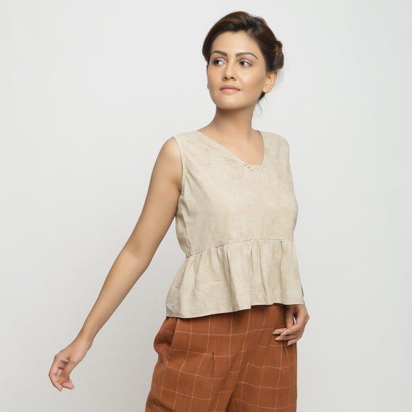 Right View of a Model wearing Beige Dabu Printed Sleeveless Gathered Top