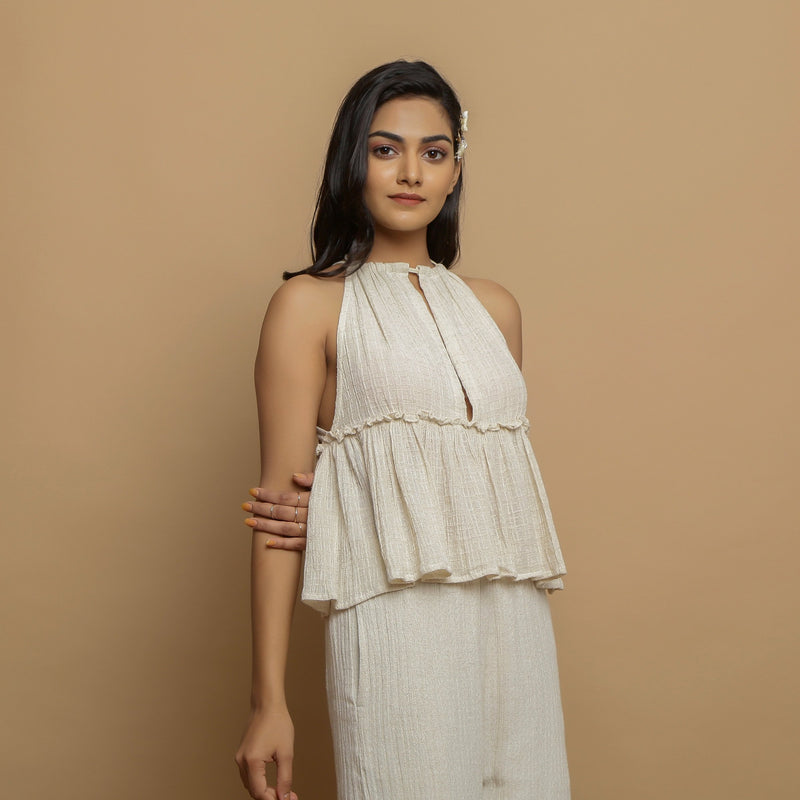 Right View of a Model wearing Ecru Cotton Flax Sleeveless Flared Top