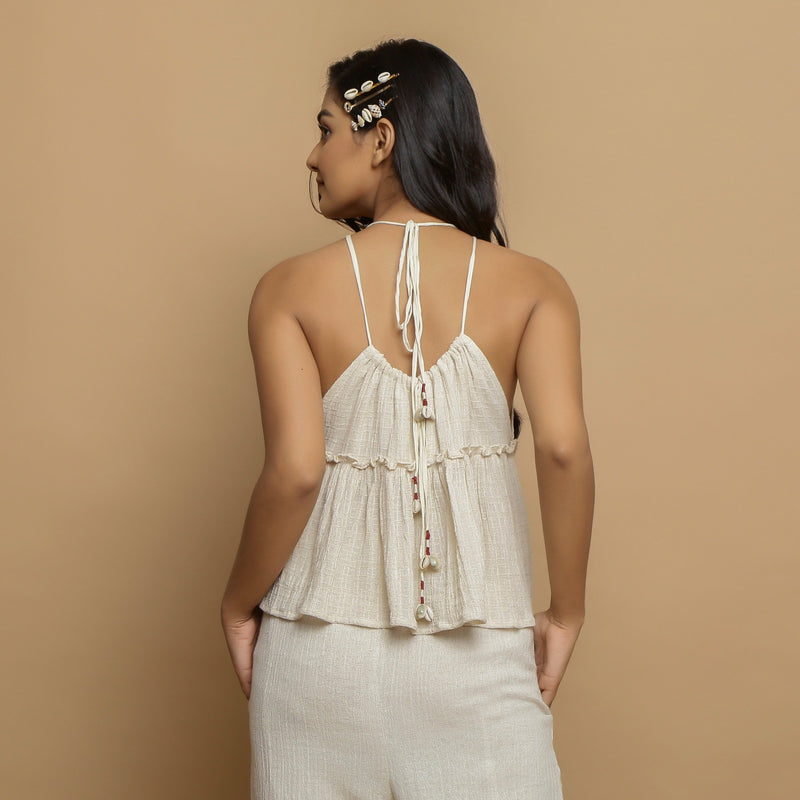 Back View of a Model wearing Ecru Cotton Flax Sleeveless Flared Top