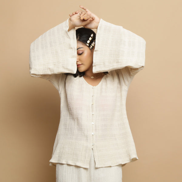 Front View of a Model wearing Ecru Cotton Flax Frilled Button-Down Top