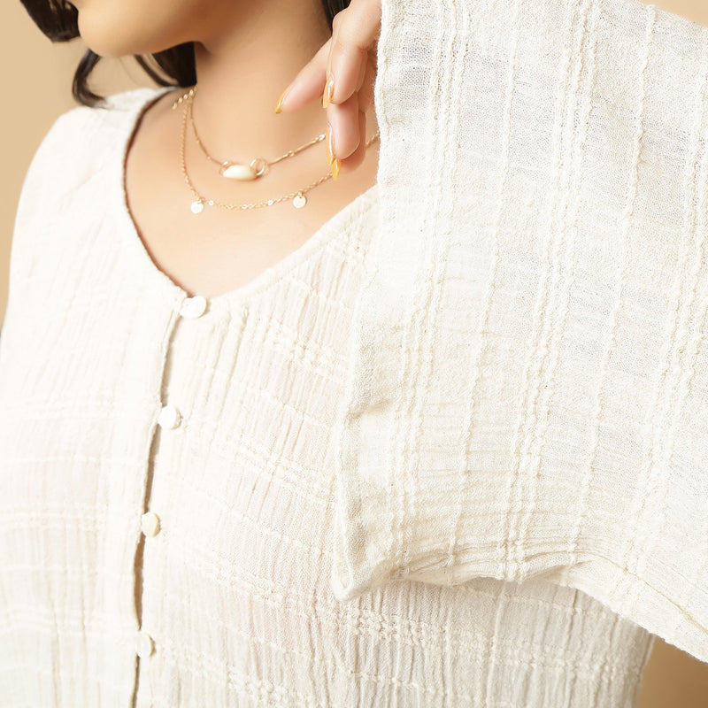 Right Detail of a Model wearing Ecru Cotton Flax Frilled Button-Down Top
