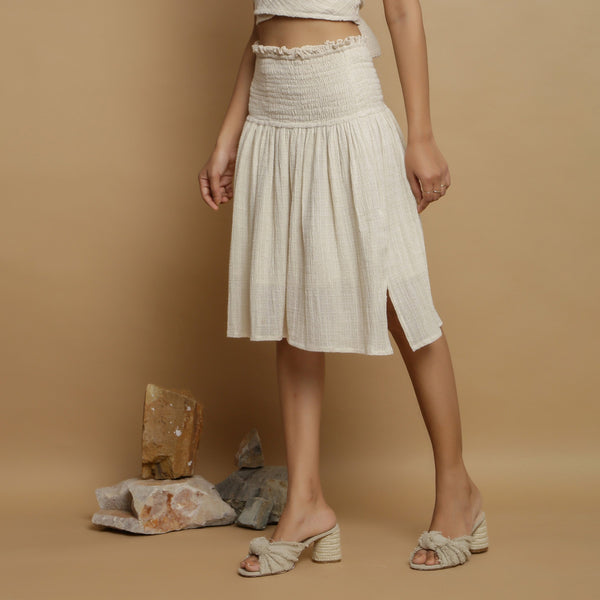 Left View of a Model wearing Undyed Cotton Flax Frilled Skirt