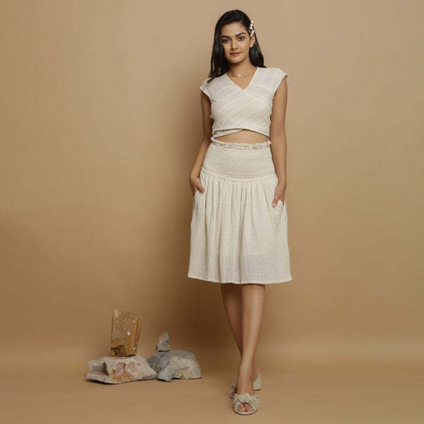 Front View of a Model wearing Ecru Cotton Flax Yoked Skirt