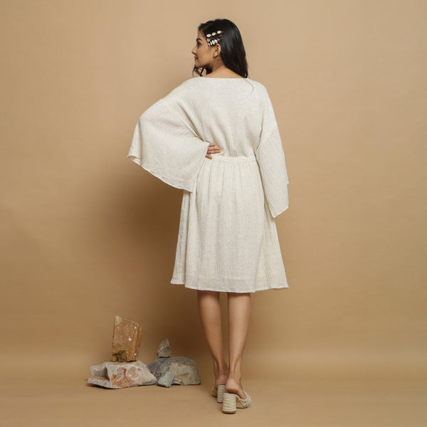Back View of a Model wearing Ecru Undyed Cotton Button-Down Dress