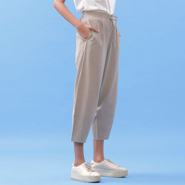 Right View of a Model wearing Essential Beige Cotton Paneled Pant