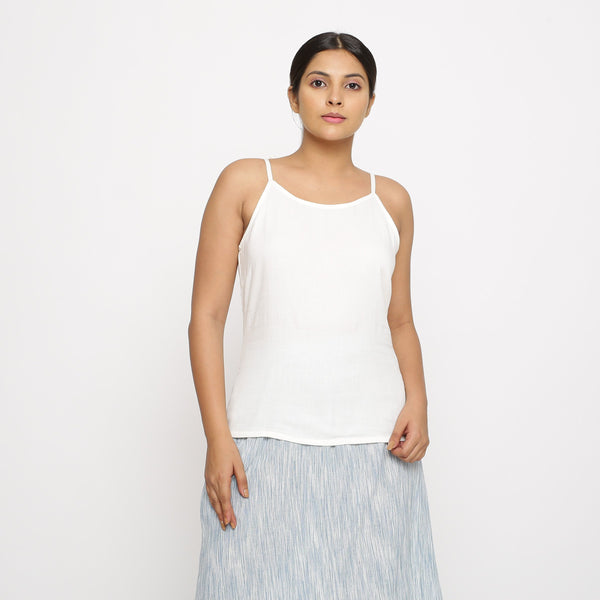 Front View of a Model wearing Solid White Cotton Moss Spaghetti Top