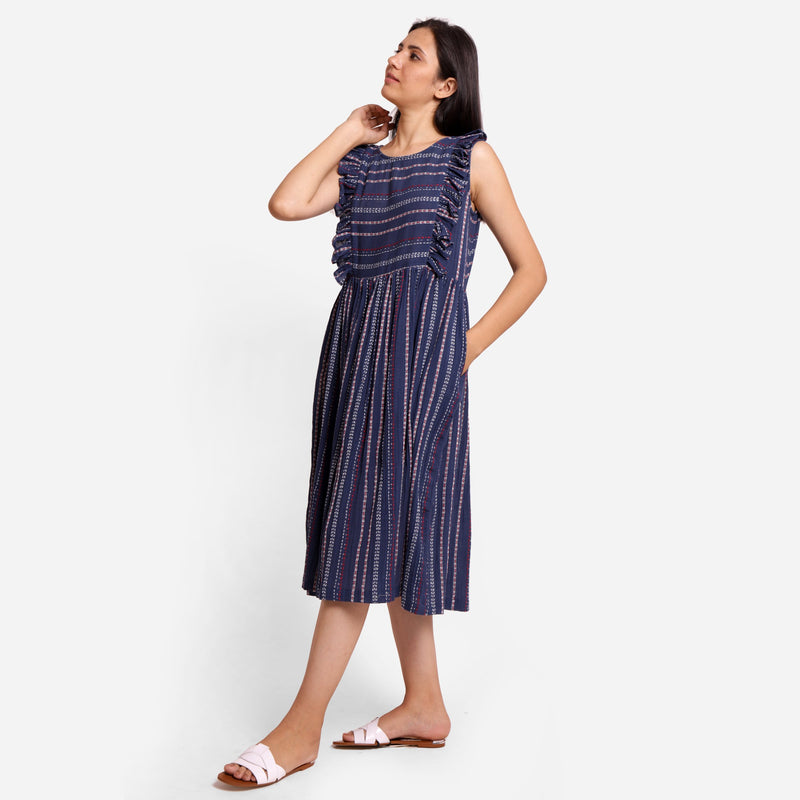 Left View of a Model wearing Navy Blue Crinkled Cotton Midi Dress