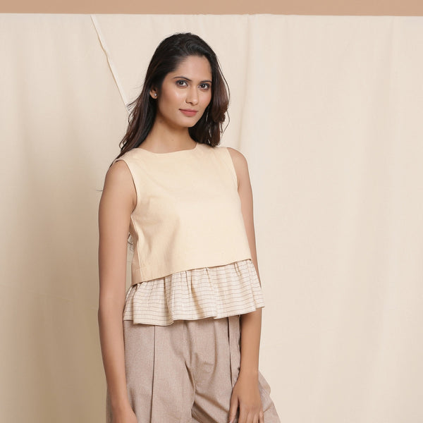 Right View of a Model wearing Beige Striped Surplice Blouson Top