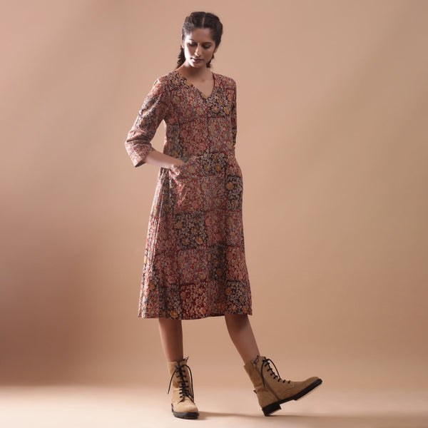 Right View of a Model wearing Flannel Kalamkari Muddy Red V-Neck Dress