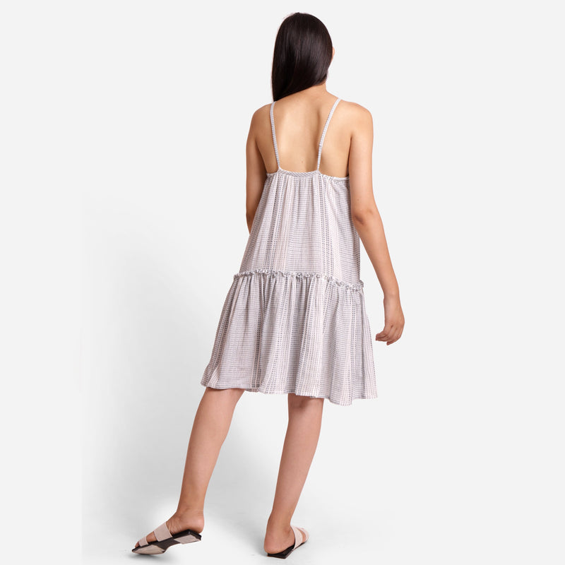 Back View of a Model wearing Flared Strappy Sun Dress
