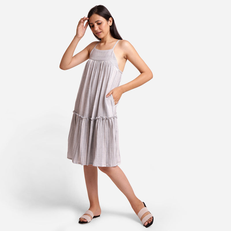 Left View of a Model wearing Flared Strappy Sun Dress
